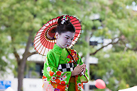 Asian girl wearing colorful green Japanese Kimono, Dragon Fest 2015, Chinatown, Seattle, Washington, USA.
