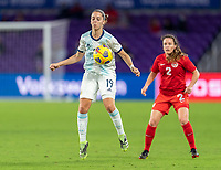 ORLANDO, FL - FEBRUARY 21: Mariana Larroquette #19 of Argentina controls the ball during a game between Canada and Argentina at Exploria Stadium on February 21, 2021 in Orlando, Florida.