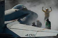 120305-N-DR144-458 ARABIAN GULF (March 5, 2012) Aviation Boatswain's Mate (Handling) 3rd Class Eric Welsh directs and F/A-18C Hornet assigned to Strike Fighter Squadron (VFA) 25 onto the bow catapults for launch on the flight deck aboard the Nimitz-class aircraft carrier USS Carl Vinson (CVN 70). Carl Vinson and Carrier Air Wing (CVW) 17 are deployed to the U.S. 5th Fleet area of responsibility.  (U.S. Navy photo by Mass Communication Specialist 2nd Class James R. Evans/Released)