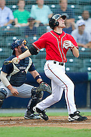Roger Kieschnick #39 of the Richmond Flying Squirrels follows through on his swing against the Harrisburg Senators in game one of a double-header at The Diamond on July 22, 2011 in Richmond, Virginia.  The Squirrels defeated the Senators 3-1.   (Brian Westerholt / Four Seam Images)