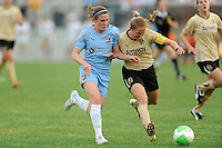 Rachel Buehler (4) of FC Gold Pride challenges Heather O'Reilly (9) of Sky Blue FC for the ball. FC Gold Pride defeated Sky Blue FC 1-0 during a Women's Professional Soccer (WPS) match at Yurcak Field in Piscataway, NJ, on May 1, 2010.