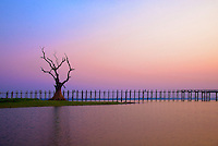 Sunrise at the U-Bein Teak Wood Bridge,  this teakwood bridge spans 1.2 km across the shallow Taungthaman Lake some 10 km south of Mandalay Amarapura, Mandalay, Myanmar, Burma