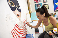 Juliana Duque works on one of her painting  Monday Sept. 7 , 2020, at her home in Bella Vista. Duque did an online work share about her career Sept. 8 as part of the conclusion of a six week program put on by Artist INC that works with artists to help them be more successful as business people.<br />(NWA Democrat-Gazette/Spencer Tirey)
