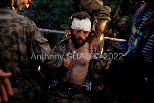 Sukhumi, Abkhazia<br /> September 27, 1993<br /> <br /> An Abkhazian separatist is wounded in an attack on Georgian forces held up inside the Parliament building. Within hours the Abkhazian separatists would control the Parliament and the city.