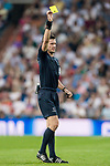 Referee Benoit Bastien shows Roland Sallai of APOEL FC the yellow card during the UEFA Champions League 2017-18 match between Real Madrid and APOEL FC at Estadio Santiago Bernabeu on 13 September 2017 in Madrid, Spain. Photo by Diego Gonzalez / Power Sport Images