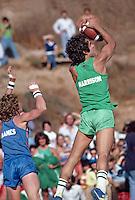 Actor Gregory Harrison catches pass during Football Game at the Battle of the Network Stars. Pepperdine University, Pepperdine CA. November, 1979. Photo by John G. Zimmerman.