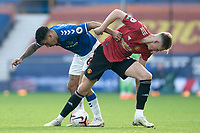 7th November 2020; Liverpool, England; Manchester Uniteds Scott McTominay vies with Evertons Allan during the Premier League match between Everton and Manchester United at Goodison Park Stadium