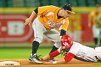 Tennessee Volunteers shortstop Will Maddox #1 tags out Jacob Lueneburg #42 of the Houston Cougars as he tries to steal second base at Minute Maid Park on March 2, 2012 in Houston, Texas.  The Cougars defeated the Volunteers 7-4.  Brian Westerholt / Four Seam Images