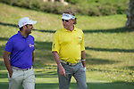 Shiv Kapur of India (in purple) and Miguel Angel Jiménez of Spain (in yellow) at the first hole during the 58th UBS Hong Kong Golf Open as part of the European Tour on 10 December 2016, at the Hong Kong Golf Club, Fanling, Hong Kong, China. Photo by Marcio Rodrigo Machado / Power Sport Images