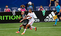 CARSON, CA - APRIL 25: Julian Araujo #2 of the Los Angeles Galaxy and Amro Tarek Abdel-Aziz #3 chase after a loose ball during a game between New York Red Bulls and Los Angeles Galaxy at Dignity Health Sports Park on April 25, 2021 in Carson, California.