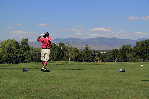 African American man playing golf at City Park Golf Course in Denver, Colorado, USA