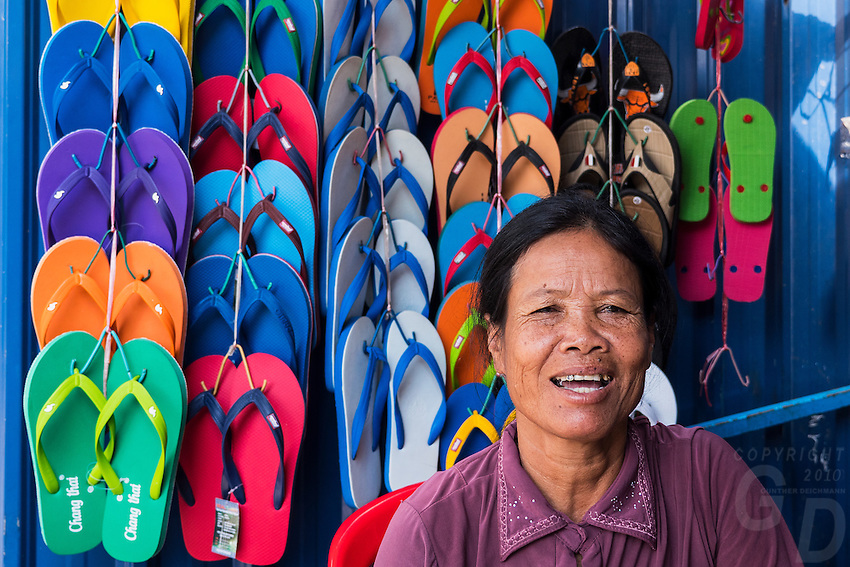 Women selling Colorful slippers in the street of Phnom Penh, Cambodia