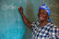 Haiti, Gros-Morne. Mercy Beyond Borders projects. Clermelia Cadet, 60 years, in MBB literacy class.