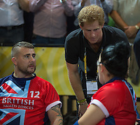 Friday 12th September 2014<br /> Picture: Prince Harry<br /> RE: Prince Harry talks with Team GB wheelchair rugby athletes at the athletes at the Invictus Games Queen Elizabeth Olympic Park, London, United Kingdom