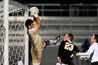 UMBC Retrievers goalkeeper Dan Louisignau (00) makes a save. UMBC Retrievers defeated Princeton Tigers 2-1 during the first round of the 2010 NCAA Division 1 Men's Soccer Championship at Roberts Stadium in Princeton, NJ, on November 18, 2010.