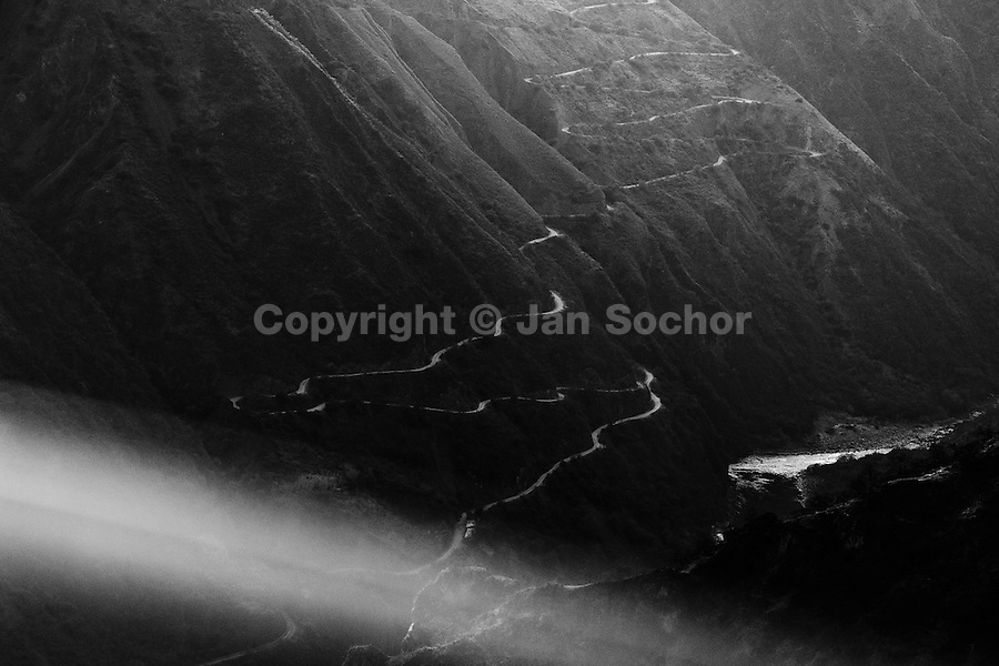The famous '24 curvas' (24 curves), a dangerous one-car-wide unpaved road, cut out of the rock, in Apurímac river canyon, Peru, 31 July 2012.