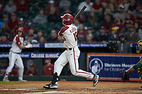 Heston Kjerstad (18) of the Arkansas Razorbacks follows through on his swing against the Baylor Bears in game nine of the 2020 Shriners Hospitals for Children College Classic at Minute Maid Park on March 1, 2020 in Houston, Texas. The Bears defeated the Razorbacks 3-2. (Brian Westerholt/Four Seam Images)