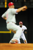 Apr. 25, 2011; Phoenix, AZ, USA; Arizona Diamondbacks baserunner Justin Upton leads off second base as Philadelphia Phillies pitcher Cliff Lee throws in the sixth inning at Chase Field. Mandatory Credit: Mark J. Rebilas-