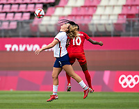 KASHIMA, JAPAN - AUGUST 2: Lindsey Horan #9 of the USWNT is fouled by Ashley Lawrence #10 of Canada during a game between Canada and USWNT at Kashima Soccer Stadium on August 2, 2021 in Kashima, Japan.