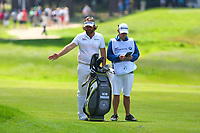 Victor Dubuisson chats with his caddy on the 16th fairway during the BMW PGA Golf Championship at Wentworth Golf Course, Wentworth Drive, Virginia Water, England on 27 May 2017. Photo by Steve McCarthy/PRiME Media Images.