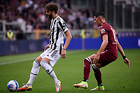 Manuel Locatelli of Juventus FC and Sasa Lukic of Torino Calcio compete for the ball during the Serie A 2021/2022 football match between Torino FC and Juventus FC at Stadio Olimpico Grande Torino in Turin (Italy), October 2nd, 2021. Photo Federico Tardito / Insidefoto
