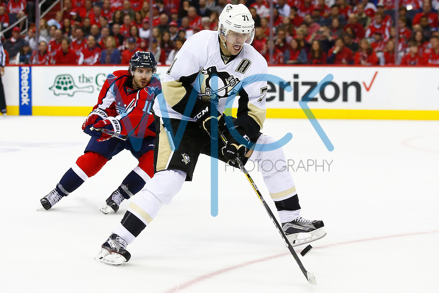 Evgeni Malkin #71 of the Pittsburgh Penguins attempts to collect a pass in the second period against the Washington Capitals during game two of the second round of the Stanley Cup Playoffs at Verizon Center in Washington D.C. on April 30, 2016. (Photo by Jared Wickerham / DKPS)