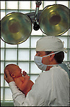 maternity doctor or father holding newborn infant