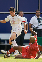 Panama's Alberto Blanco attempts a tackle on USA's Santino Quaranta. The United States defeated Panama 3-1 in a shoot out after a scoreless game to win the CONCACAF Gold Cup at Giant's Stadium, East Rutherford, NJ, on July 24, 2005.
