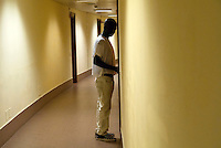 Un profugo proveniente dalla Libia, alloggiato al residence Ripamonti, nella sua stanza. Pieve Emanuele (Milano), 26 maggio 2011...Fugitive from Libya, lodged in Ripamonti Residence, in his room. Pieve Emanuele (Milan), May 26, 2011