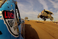 Dec. 11, 2011; Chandler, AZ, USA; Onboard view from the truck of LOORRS pro two unlimited driver Robby Woods as Carl Renezeder takes a jump alongside during the Lucas Oil Challenge Cup at Firebird International Raceway. Mandatory Credit: Mark J. Rebilas-