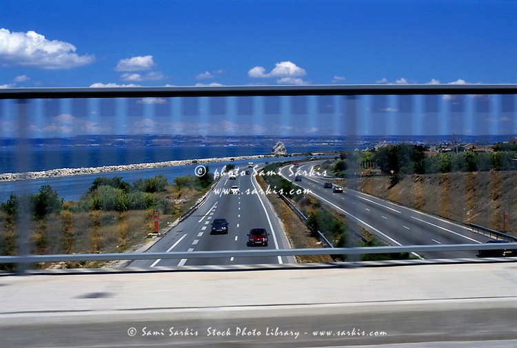 Speeding cars along the A55 Highway seen from an overpass, La Mede, Provence, France.