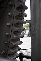 The massive teeth of a gear on the 4th Street Bridge in San Francisco.