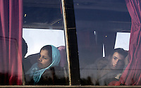 Pictured: Two migrant look through one of the coaches used to transfer them Tuesday 23 February 2016<br /> Re: Migrants trying to cross the Greek-FYRO Macedonian border, were turned away by the authorities in Idomeni, Greece.