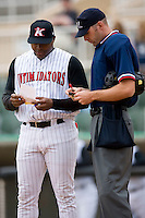 Kannapolis manager Chris Jones goes over lineup changes with home plate umpire Tom Walkoviak at Fieldcrest Cannon Stadium in Kannapolis, NC, Wednesday, April 18, 2007.  The River Dogs defeated the Intimidators by the score of 1-0.