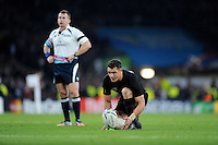 Dan Carter of New Zealand takes a conversion attempt as Referee Nigel Owens of Wales looks on during the Rugby World Cup Final between New Zealand and Australia - 31/10/2015 - Twickenham Stadium, London<br /> Mandatory Credit: Rob Munro/Stewart Communications