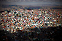 A panoramic view of El Alto.Just 25 years ago it was a small group of houses around La Paz  airport, at an altitude of 12,000 feet. Now El Alto city  has  nearly one million people, surpassing even the capital of Bolivia, and it is the city of Latin America that grew faster .<br /> 	It is also a paradigmatic city of the troubles  and traumas of the country. There got refugee thousands of miners that lost  their jobs in 90 ´s after the privatization and closure of many mines. The peasants expelled by the lack of land or low prices for their production. Also many who did not want to live in regions where coca  growers and the Army  faced with violence.<br /> 	In short, anyone who did not have anything at all and was looking for a place to survive ended up in El Alto.<br /> 	Today is an amazing city. Not only for its size. Also by showing how its inhabitants,the poorest of the poor in one of the poorest countries in Latin America, managed to get into society, to get some economic development, to replace their firs  cardboard houses with  new ones made with bricks ,  to trace its streets,  to raise their clubs, churches and schools for their children.<br /> 	Better or worse, some have managed to become a sort of middle class, a section of the society that sociologists call  emerging sectors. Many, maybe  most of them, remain for statistics as  poor. But clearly  all of them have the feeling they got  for their children a better life than the one they had to face themselves .