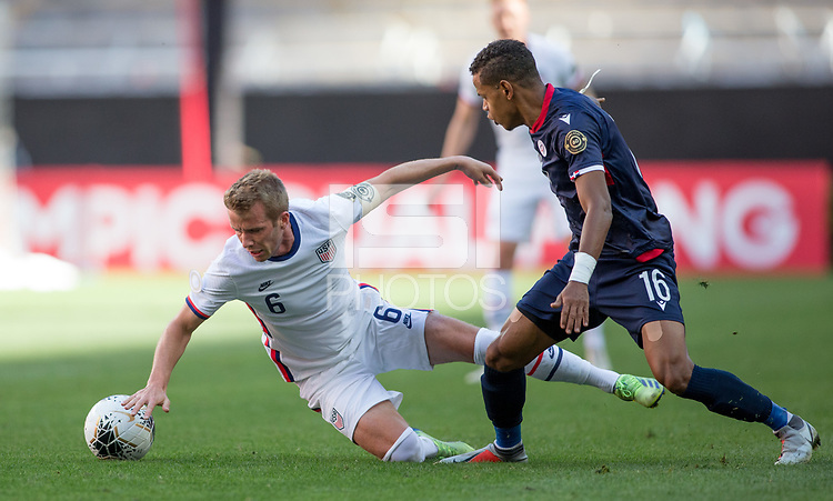 ZAPOPAN, MEXICO - MARCH 21: Jackson Yueill #6 of the United States tgets knocked to the ground during a game between Dominican Republic and USMNT U-23 at Estadio Akron on March 21, 2021 in Zapopan, Mexico.