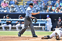 Home plate umpire Matthew Brown makes the out call during a game between the Augusta GreenJackets and the Asheville Tourists at McCormick Field on July 16, 2017 in Asheville, North Carolina. The GreenJackets defeated the Tourists 10-9. (Tony Farlow/Four Seam Images)