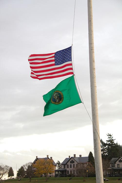 American flag, flag at half mast, Washington State flag, Port Townsend, Fort Worden, State Park, Washington State,
