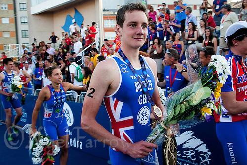 25 JUN 2011 - PONTEVEDRA, ESP - Alistair Brownlee (GBR) walks form the medal ceremony after his victory at the Elite Men's European Triathlon Championships in Pontevedra, Spain.(PHOTO (C) NIGEL FARROW)