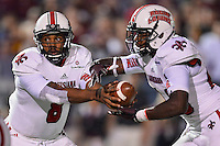Louisiana Lafayette quarterback Terrance Broadway (8) handoff to running back Alonzo Harris (46) during first half of an NCAA football game, Tuesday, October 14, 2014 in San Marcos, Tex. Louisana Lafayette leads 21-3 at the halftime. (Mo Khursheed/TFV Media via AP Images)