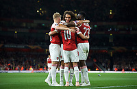 Mattéo Guendouzi of Arsenal and teammates celebrate with goal scorer Mesut Özil of Arsenal during the UEFA Europa League match group between Arsenal and Vorskla Poltava at the Emirates Stadium, London, England on 20 September 2018. Photo by Andrew Aleksiejczuk / PRiME Media Images.