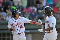 First baseman Josh Ockimey (18) of the Greenville Drive is congratulated By Tate Matheny after hitting a home run in a game against the Columbia Fireflies on Sunday, May 8, 2016, at Fluor Field at the West End in Greenville, South Carolina. Greenville won, 5-4. (Tom Priddy/Four Seam Images)