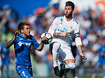Sergio Ramos of Real Madrid (R) fights for the ball with Alvaro Jose Jimenez Guerrero of Getafe CF (L) during the La Liga 2017-18 match between Getafe CF and Real Madrid at Coliseum Alfonso Perez on 14 October 2017 in Getafe, Spain. Photo by Diego Gonzalez / Power Sport Images