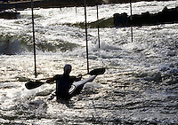 Person kayaking in white water