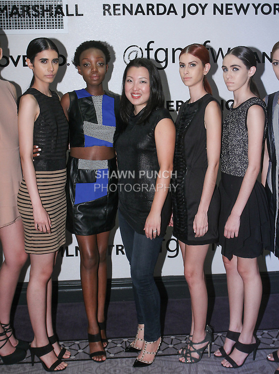 Fashion designer Claire Henkel (center) poses with models, after her Urban Sewn Spring Summer 2016 collection fashion show, at the Fashion Gallery NYFW Designer's Collective Spring Summer 2016 show, during New York Fashion Week.