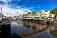 Looking at the Ha'Penny Bridge in Dublin over the Liffey River.