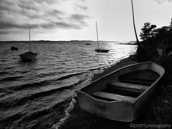 Beached boat with others on the bay
