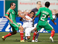05 July 2009: Marlon Medina of the Nicaragua kicks the ball away from Mexico's Gerardo Torrado and Jonny Magallon during the game at Oakland-Alameda County Coliseum in Oakland, California.    Mexico defeated Nicaragua, 2-0.