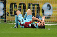 Stephen Ward of Burnley lies injured on the ground during the Premier League match between Swansea City and Burnley at The Liberty Stadium, Swansea, Wales, UK. Saturday 04 March 2017